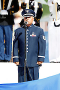 A member of the U.S. military sings the National Anthem during the 2012 NFL Pro Bowl football game between the AFC All-Stars and the NFC All-Stars on Sunday, January 29, 2012 in Honolulu, Hawaii. The AFC won the game 59-41. ©Paul Anthony Spinelli