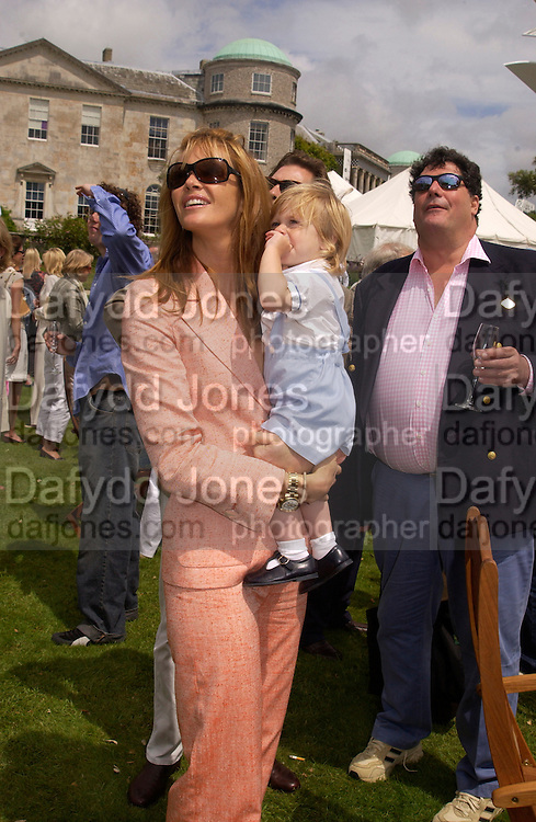 Elle Macpherson and Cy Busson, Cartier Style Et Luxe, Goodwood, 27 June 2004. SUPPLIED FOR ONE-TIME USE ONLY-DO NOT ARCHIVE. © Copyright Photograph by Dafydd Jones 66 Stockwell Park Rd. London SW9 0DA Tel 020 7733 0108 www.dafjones.com