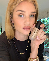 "Rosie Huntington-Whiteley releases a photo on Instagram with the following caption: ""One of my favorite #bareminerals products, BAREPRO Liquid Foundation SPF 15, is now available to customize to your unique skin tone using the @bareminerals #MADE2FIT app! Simply download the app to create a bespoke blend of makeup made fresh\u2014just for you. Plus, the bottle comes with your name on it! #Ad"". Photo Credit: Instagram *** No USA Distribution *** For Editorial Use Only *** Not to be Published in Books or Photo Books ***  Please note: Fees charged by the agency are for the agency's services only, and do not, nor are they intended to, convey to the user any ownership of Copyright or License in the material. The agency does not claim any ownership including but not limited to Copyright or License in the attached material. By publishing this material you expressly agree to indemnify and to hold the agency and its directors, shareholders and employees harmless from any loss, claims, damages, demands, expenses (including legal fees), or any causes of action or allegation against the agency arising out of or connected in any way with publication of the material."