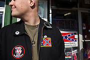 An American Nazi Party member gathers outside the Redneck Shop December 5, 2009 in Laurens, SC during the 7th Annual White Unity Christmas Party held by the American Nazi Party & International Knights of the Ku Klux Klan.