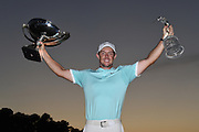 ATLANTA, GA - SEPTEMBER 25:  Rory McIlroy of Northern Ireland poses with the FedExCup and the Tour Championship trophy after winning the TOUR Championship, the final event of the FedExCup Playoffs, at East Lake Golf Club on September 25, 2016 in Atlanta, Georgia. (Photo by Chris Condon/PGA TOUR)