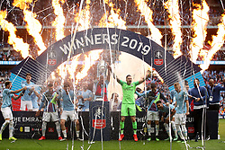 Manchester City goalkeeper Ederson (centre) celebrates with team mates after winning the FA Cup Final at Wembley Stadium, London.