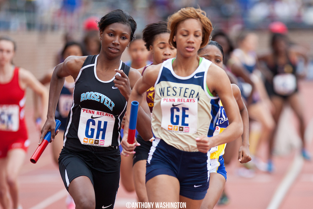 Erika Malloy of Eleanor Roosevelt High School runs the second leg of the 4x400 High School Girls qualifier during the Penn Relays athletic meets on Thursday, April 26, 2012 in Philadelphia, PA.