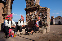 TAQUILE ISLAND, PERU - CIRCA OCTOBER 2015: Men having a conversation in Taquile Island main square, in Lake Titicaca, Peru.