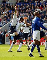 Photograph: Scott Heavey.<br />Leicester City v Tottenham Hotspur. 19/10/2003. FA Barclaycard Premiership.<br />Robbie Keane jumps on the back of goal scorer Freddie Kanoute