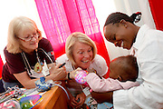 Swedish nurse Mariana Ahfeldt and American nurse Sharon Neece examine children as they pass through the screening process...Operation Smile South Africa.Clinique Ngaliema, Avenue Des Cliniques.KInshasa, DRC Mission, June 3rd-12th 2011..© Zute & Demelza Lightfoot.www.lightfootphoto.com...
