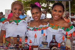 "(L-R) ChaCha Garcia, Reynita Clark, and Sharifa Joseph serve drinks to thirsty patrons at Tipsy's.  The Festival & Cultural Organization of St. John Presents It's Annual Food Fair honoring Delroy ""Ital"" Anthony and Royal Coronation 2016.  Franklin A. Powell, Sr. Park.  St. John, US Virgin Islands.  26 June 2016.  © Aisha-Zakiya Boyd"