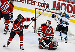 February 20, 2008; Newark, NJ, USA; New Jersey Devils goalie Martin Brodeur (30) makes a save through a screen by San Jose Sharks center Torrey Mitchell (17) as New Jersey Devils defenseman Mike Mottau (27) defends during the third period at the Prudential Center in Newark, NJ.  The Devils beat the Sharks 3-2.
