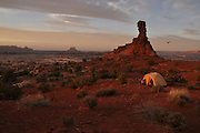 The sun sets across a tent campsite perched on the edge of the Maze District of Canyonlands National Park, Utah.