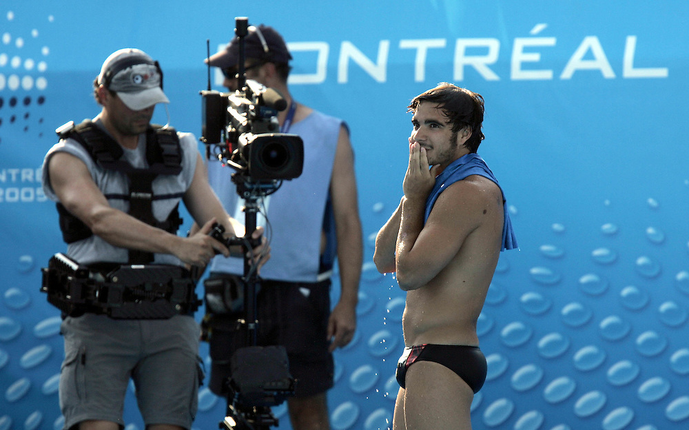 Canada's Alexandre Despatie reacts after winning the gold medal in the final round of the men's 1M springboard competition at the FINA World Championships in Montreal, Quebec Thursday 21 July 2005. Alexandre Despatie of Canada took the gold, Xu Xiang of CHina took the silver and Wang Feng of CHina took the bronze.