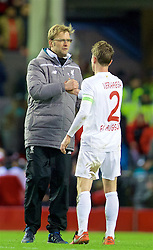 LIVERPOOL, ENGLAND - Thursday, February 25, 2016: Liverpool's manager Jürgen Klopp with FC Augsburg's Paul Verhaegh after the UEFA Europa League Round of 32 1st Leg match at Anfield. (Pic by David Rawcliffe/Propaganda)