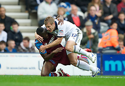 PRESTON, ENGLAND - Saturday, September 24, 2011: Tranmere Rovers' Lucas Akins and Preston North End's Paul Parry lock arms during the Football League One match at Deepdale. (Pic by Dave Kendall/Propaganda)