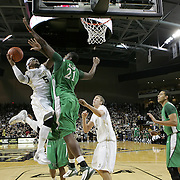 Central Florida guard Marcus Jordan (5) shoots past Marshall center Orlando Allen (21) during a Conference USA NCAA basketball game between the Marshall Thundering Herd and the Central Florida Knights at the UCF Arena on January 5, 2011 in Orlando, Florida. Central Florida won the game 65-58 and extended their record to 14-0.  (AP Photo/Alex Menendez)