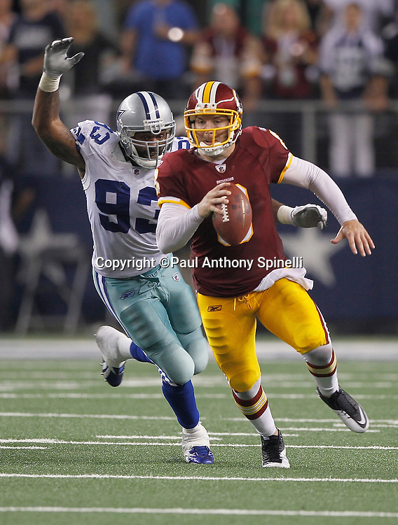 Washington Redskins quarterback Rex Grossman (8) scrambles and gets stripped of the ball from behind by Dallas Cowboys outside linebacker Anthony Spencer (93) causing a fumble recovered by the Dallas Cowboys and sealing the win during the NFL week 3 football game against the Dallas Cowboys on Monday, September 26, 2011 in Arlington, Texas. The Cowboys won the game 18-16. ©Paul Anthony Spinelli