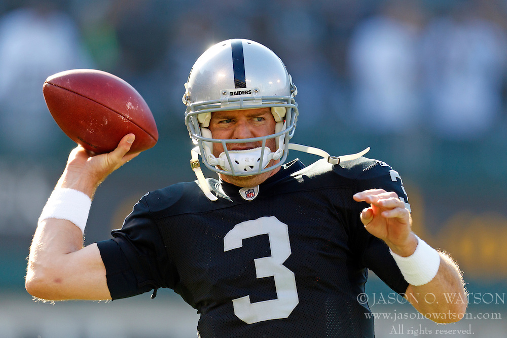 Jan 1, 2012; Oakland, CA, USA; Oakland Raiders quarterback Carson Palmer (3) warms up before the game against the San Diego Chargers at O.co Coliseum. Mandatory Credit: Jason O. Watson-US PRESSWIRE