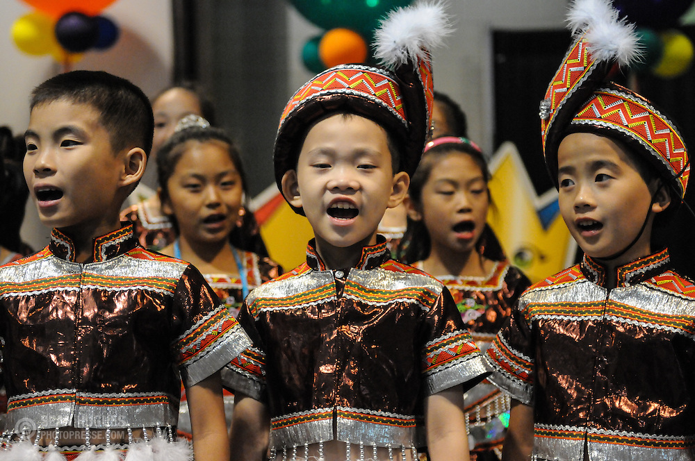 Parade of Nations - Lively, China. The 2012 World Choir Games kicked off the second week of competition with an impressive parade through the streets of downtown Cincinnati. The Games, which started on July 4, continue through July 14, bringing together more than 360 choirs to the Cincinnati area. (Photo: Sean Hughes)