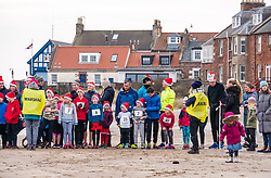 Pictured: Santa Beach Run on the scenic East Lothian coast. This new event is aimed at athletes, casual runners and families. It is hosted by Project Trust with proceeds enabling local school leavers to spend a year volunteering in India/Honduras to teach at a school with few teaching materials. Children get ready for their 2km race.15 December 2018  <br /> <br /> Sally Anderson | EdinburghElitemedia.co.uk
