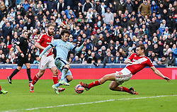 Middlesbrough's Ben Gibson challenges Manchester City's David Silva  - Photo mandatory by-line: Matt McNulty/JMP - Mobile: 07966 386802 - 24/01/2015 - SPORT - Football - Manchester - Etihad Stadium - Manchester City v Middlesbrough - FA Cup Fourth Round