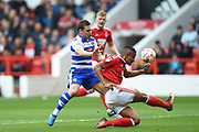 Nottingham Forest defender Michael Mancienne (4) holds off Reading striker Adrian Popa (25) during the EFL Sky Bet Championship match between Nottingham Forest and Reading at the City Ground, Nottingham, England on 22 April 2017. Photo by Jon Hobley.