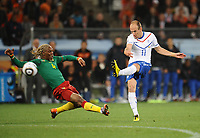 Football - 2010 FIFA World Cup - Netherlands vs. Cameroon<br /> Arjen Robben of the Netherlands hits the post with a shot, Klaas-Jan Huntelaar then scores their second goal from the rebound at Green Point Stadium, Cape Town