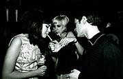 Two Teenagers Lighting A Cigarette, Mod Club