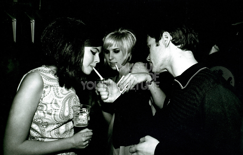 Two Teenagers Lighting A Cigarette, Mod Club