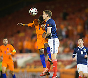 9th November 2017, Pittodrie Stadium, Aberdeen, Scotland; International Football Friendly, Scotland versus Netherlands; Holland's Quincy Promes competes in the air with Scotland's Christophe Berra