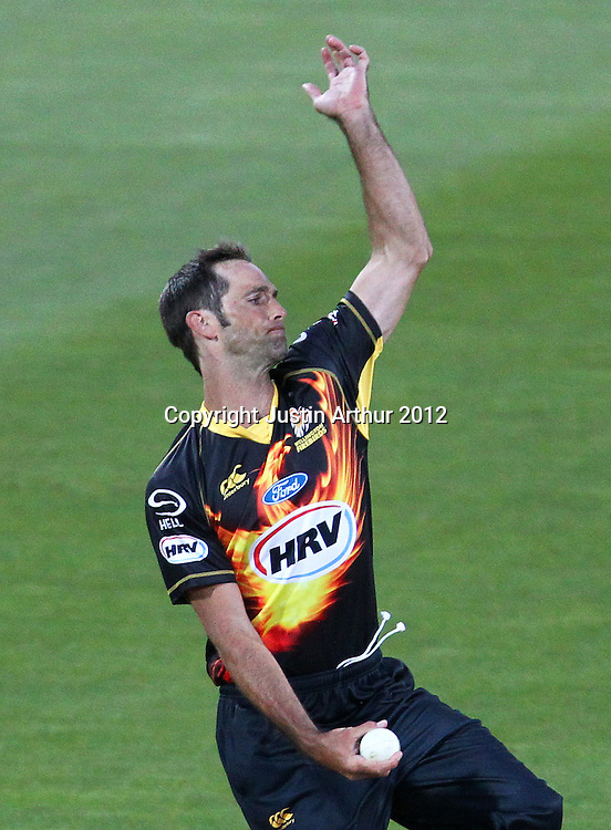 Firebirds' Grant Elliott bowling during the 2012/2013 HRV Cup Twenty20 session. Wellington Firebirds v Canterbury Wizards at Westpac Stadium, Wellington, New Zealand on Friday 9 November 2012. Photo: Justin Arthur / photosport.co.nz