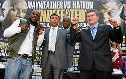 September 19, 2007; New York, NY, USA; World Welterweight Champion Floyd Mayweather Jr (l) and World Junior Welterweight Champion Ricky Hatton (r) pose with Oscar DeLaHoya at the press conference announcing their December 8, 2007 fight.  The fight will take place at the MGM Grand Garden Arena in Las Vegas, Nevada.
