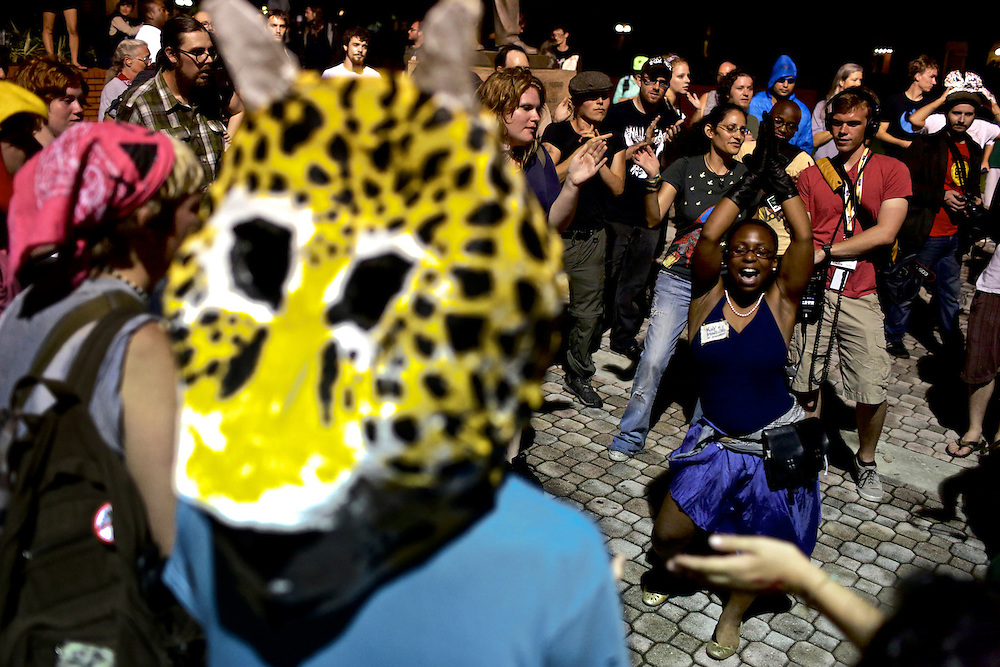 Sparro Kennedy dances while protestors watch at a rally in Ybor City during the 2012 Republican National Convention in Tampa, Fla. on Aug. 27, 2012. Photo by Greg Kahn
