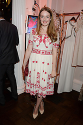 Actress CARA THEOBOLD at the launch of Gordon's 'Ten Green Bottles' by Temperley London held at Temperley London Flagship, 27 Bruton Street, London on 6th November 2013.