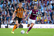 Hull City midfielder Sam Clucas (11) sprints forward with the ball under pressure from Aston Villa midfielder Henri Lansbury (8) during the EFL Sky Bet Championship match between Aston Villa and Hull City at Villa Park, Birmingham, England on 5 August 2017. Photo by Dennis Goodwin.