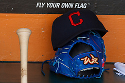 SAN FRANCISCO, CA - APRIL 26:  Detailed view of a Cleveland Indians hat and baseball glove belonging to Chen-Chang Lee #20 of the Cleveland Indians (not pictured) in the dugout before the game against the San Francisco Giants at AT&T Park on April 26, 2014 in San Francisco, California. The San Francisco Giants defeated the Cleveland Indians 5-3.  (Photo by Jason O. Watson/Getty Images) *** Local Caption ***