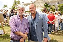 Left to right, GEORGE LUCAS and JONATHAN IVE at a luncheon hosted by Cartier for their sponsorship of the Style et Luxe part of the Goodwood Festival of Speed at Goodwood House, West Sussex on 4th July 2010.