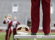"""Drum Major Michelle Aberle directs the The Lynx Marching Band during their performance at the State Marching Band Festival at Kingston Stadium in Cedar Rapids on Saturday October 6, 2012. Their program included """"You Give Love a Bad Name"""", """"Wanted Dead or Alive"""", and """"Livin' on a Prayer""""."""