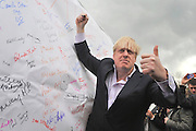 © Licensed to London News Pictures. 27/04/2013. London, UK. Mayor of London, Boris Johnson, signs a petition against the expansion of Heathrow Airport. A rally against Heathrow expansion takes place today 27th April on Barn Elms Playing Field in Barns, West London.  The rally organised by MP Zac Goldsmith included Mayor of London, Boris Johnson, Cabinet Minister Justine Greening, and many other MPs, MEPs, Council Leaders, and campaigners as speakers. Photo credit : Stephen Simpson/LNP