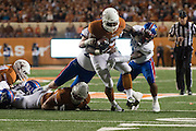 AUSTIN, TX - NOVEMBER 7:  D'Onta Foreman #33 of the Texas Longhorns breaks free against the Kansas Jayhawks on November 7, 2015 at Darrell K Royal-Texas Memorial Stadium in Austin, Texas.  (Photo by Cooper Neill/Getty Images) *** Local Caption *** D'Onta Foreman
