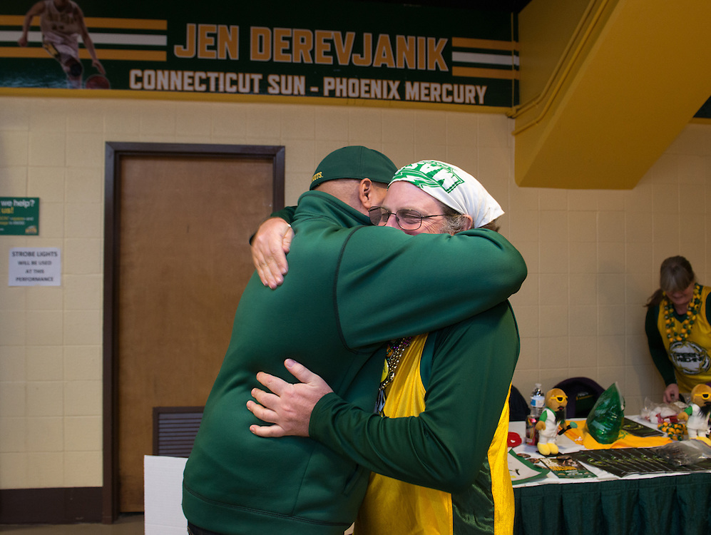 December 5, 2015 - Fairfax, VA - A day in the life of &quot;Doc Nix,&quot; aka Dr. Michael Nickens, the Director of the Athletic Bands for George Mason University. Here Doc NIx hugs booster John Hanks.<br /> <br /> Photo by Susana Raab