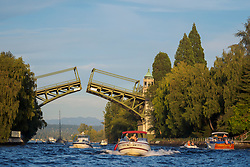 "United States, Washington, Seattle. The Montlake Bridge spans the ""Montlake Cut"" looking east from Portage Bay to Lake Washington and Cascade Mountains in the distance."