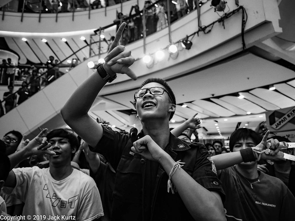 """25 JANUARY 2019 - BANGKOK, THAILAND: Young men react to women Japanese performers during a """"J Pop"""" (Japanese Pop music) concert at the Japan Expo in Central World, a shopping mall in Bangkok.      PHOTO BY JACK KURTZ"""