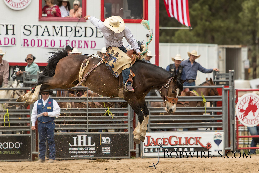 Saddle brond rider Wyatt Kammerer rides Summit Pro Rodeo's 21 during the third performance of the Elizabeth Stampede on Sunday, June 3, 2018.