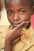 Boy holding elastic bands at an orphanage and school in N'Djamena, Chad on Thursday June 10, 2010.