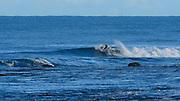 Surfing Tunnels Beach, Haena, Kauai, Hawaii