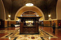 28 July 2005:  Amtrak SurfLiner train from Anaheim to Santa Barbara, CA.  Union Station information booth empty late at night inside a Los Angeles Landmark near downtown Los Angeles.