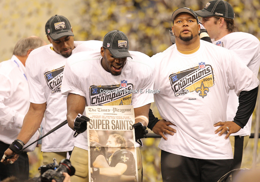 Jan 24, 2010; New Orleans, LA, USA; New Orleans Saints linebacker Jonathan Vilma celebrates with teammate safety Darren Sharper (left) and former player Deuce McAllister (right) following a 31-28 overtime victory by the New Orleans Saints over the Minnesota Vikings in the 2010 NFC Championship game at the Louisiana Superdome. Mandatory Credit: Derick E. Hingle-US PRESSWIRE