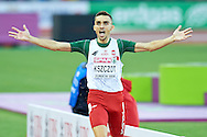 Adam Kszczot from Poland celebrates his victory and gold medal in men's 800 meters final during the Fourth Day of the European Athletics Championships Zurich 2014 at Letzigrund Stadium in Zurich, Switzerland.<br /> <br /> Switzerland, Zurich, August 15, 2014<br /> <br /> Picture also available in RAW (NEF) or TIFF format on special request.<br /> <br /> For editorial use only. Any commercial or promotional use requires permission.<br /> <br /> Photo by © Adam Nurkiewicz / Mediasport