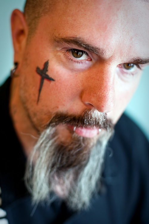 "JEROME A. POLLOS/Press..Once Layn Hamilton found a way out of his troubled life through Jesus Christ, he began using his body as a way to profess his faith with tattoos featuring scriptures, the words ""Jesus Christ"" written in Japanese on his right hand, crucifixes and other Christian statements."