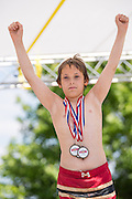 A young man raises his hands in victory after winning the overall champion Red Neck during the 2015 National Red Neck Championships May 2, 2015 in Augusta, Georgia. Hundreds of people joined in a day of country sport and activities.