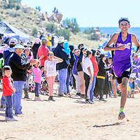 Miyamura Patriot Ty McCray grits his teeth in the final meters of the boys varsity race to finish in first place at the Zuni Invitational cross country meet in Zuni Saturday.