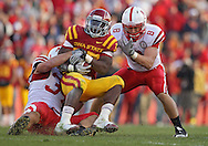 November 06 2010: Iowa State Cyclones running back Alexander Robinson (33) is pulled down by Nebraska Cornhuskers defensive end Cameron Meredith (34) and Nebraska Cornhuskers safety Austin Cassidy (8) during the second half of the NCAA football game between the Nebraska Cornhuskers and the Iowa State Cyclones at Jack Trice Stadium in Ames, Iowa on Saturday November 6, 2010. Nebraska defeated Iowa State 31-30.